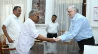 Shri. V S Achuthanandan handing over a petition on compensation from  Central  University of  Kerala